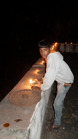 Dashrath lighting Diyas on Divali Oct 2019